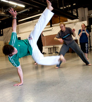 Students participate in a student led fitness activity called Capoeira. Capoeira is a Brazilian art form that combines martial arts, music, and dance.