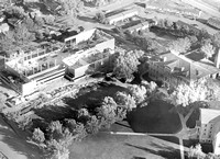 1955 Aerial photo with Spori Building and the Kirkham Building under construction.
