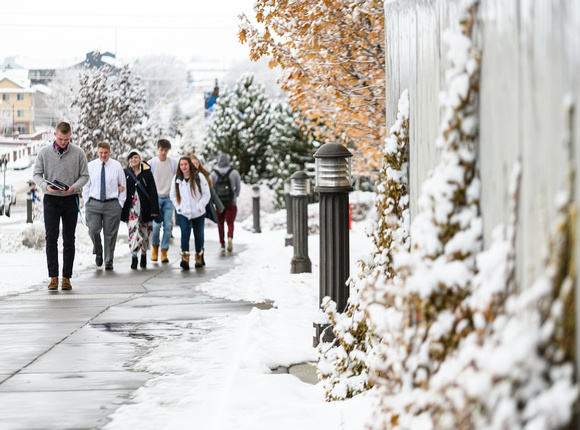 Students walking into devotional in the snow.