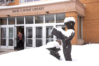 Book Worm Statue in front of David O. McKay Library covered with snow.