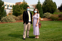 Students smiling at the camera on BYU-Idaho campus after church on a Sunday. Wearing face masks due to the COVID-19 pandemic.