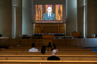 Students watch the Sunday Afternoon session of General Conference at the Taylor Chapel while social distancing and wearing masks.