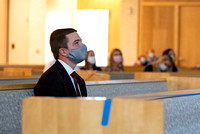 A student wearing a face mask watches general conference in the Taylor Chapel at BYU-Idaho.