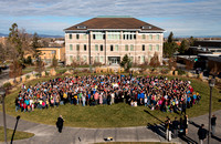 Nearly a thousand people gather in the Spori Quad for a historical photo celebrating 125 years of Ricks/BYU-Idaho.