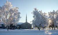 The Church of Jesus Christ of Latter Day Saints old gray church house in Sugar City, Idaho on a frosty winter day.