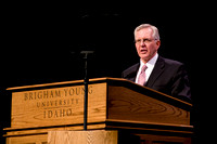 Elder Christofferson speaking and Elder Christofferson and his wife interacting with students