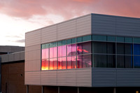 The Hyrum Manwaring Center's southeast, third floor windows reflecting the setting sun.