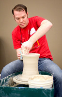 Student molding pottery.