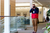 Tyler Rickenbach, University Relations Photographer, get his picture taken in the Ricks Building.