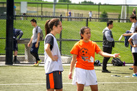 Vice President of the Latino Association, Tanya Rickenbach, talks with a player on her team during the World Cup Soccer Tournament.