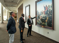 The Ugandan Minister of State for Relief, Disaster Preparedness and Refugees, enjoys a tour of BYU-Idaho, accompainie by David Pigott and Brett Sampson. His son is a student here at the University.