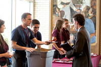 Students check in to the conference.