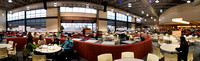 A panoramic image of students eating and socializing in the Crossroads dining area on the second floor of the Manwaring Center.