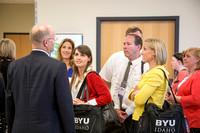 BYU-Idaho Faculty speak together as they wait for the banquet to begin.