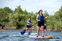 Students of Brigham Young University-Idaho go standup paddle boarding on the river at Warm Slough.