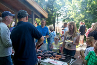 Ricks College Alumni, who competed in basketball, come together for a BBQ dinner with their families.
