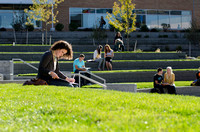 Students study and soak in the sun in the new amphitheater between the Manwaring Center and McKay Library.