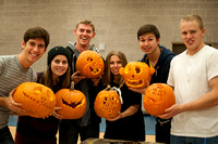 The finished products at a pumpkin carving activity on campus.