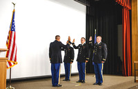 MAJ (Retired) Wilson delivers the officer's oath to 2LT Kwan-Jin Bloomfield, Joshua T. Cheesmore, and Mathew Skylar Plummer during the BYU-Idaho ROTC Commissioning Ceremony.