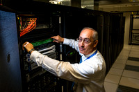 George Cromwell, the System Administrator of the IT Department, works in the network room on campus.