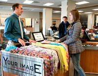 Students from the IBC Business class sell ties and scarfs in the MC Building.