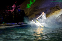 Contestants board, ski, or sled down a hill into a pool of water and attempt to use their momentum to skim to the other side.