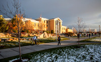 The shining sun melts the last traces of snow in front of the Gordon B. Hinckley Building.