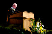 Elder Steven E. Snow speaking at the College of Business and Communications Convocation.
