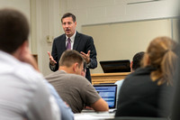 Business Management Faculty, Jeff Morrin, teaching an Advanced Financial Management class in Smith 440.