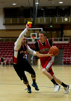 88er's Dallin Benson goes up against Knight's Jack Keck during the Men's Basketball Championship Game.