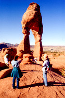 Students photograph and examine Delicate Arch in Arches National Park.