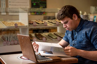 Blake Jensen studies for an Online class at the Cocoa Bean Cafe in Rexburg, ID.