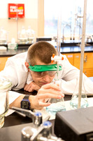 Students in Brother Les Manner's Chemistry 105 class perform basic experiments.