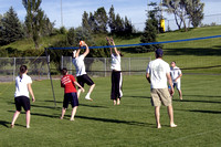 Grass volleyball being played at the upper playing fields.