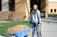A student works on the campus grounds.