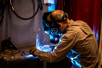 Clay Rasmussen, from the Mechanical Engineering Department, welds during a demonstration.