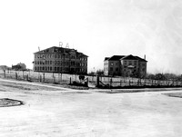 View of the Ricks Academy Building (left) and Gym Building (right) around 1919 or 1920