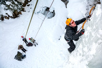 Anthony Asplund climbing up the ice face.