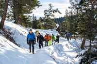 Davin Lybbert leads with a groups of students to go ice climbing.
