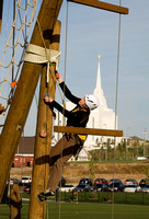 Abby Stevens climbing the Tower with the Rexburg Temple in the background.