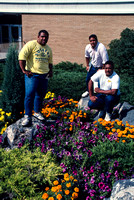 Ricks College students standing in flowers they just planted
