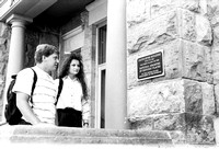 Students looking at a plaque on the Spori Building