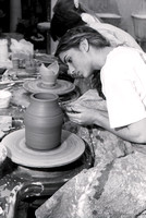 Art student works diligently on a piece of pottery for Ceramics class.