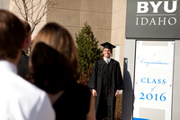 Graduates gather outside the I-Center to take pictures before Commencement.