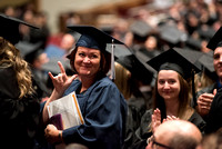 Graduates thanking their friends and family during Convocation ceremony. Photo by Ryan Chase