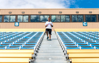 Students get a grueling workout running the Stadium Stairs.