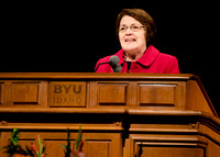 Sister Sue Clark speaking at a devotional.
