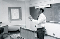 Business teacher, Phillip Packer teaches students in the classroom. December 1995.
