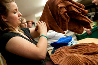 Devotional Ushers volunteer at the Family Crisis Center on Main St., by sorting food and folding bedding.