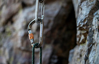 Detail shots of a carabiner. (Climbing wall up Kelly Canyon)